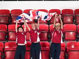 Cheering boys with flag