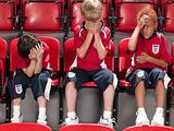 Boys despairing at football