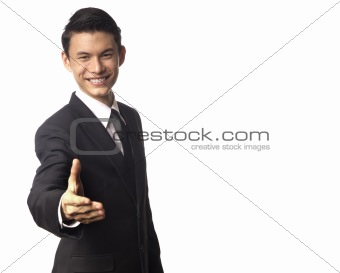 Young Asian Corporate Man Offering a Hand Shake Over White Background