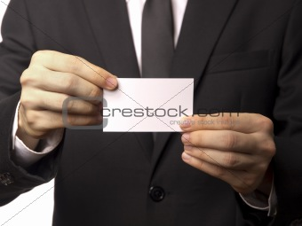 Corporate Man in Black Suit Displaying a White Card