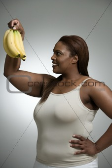 Woman looking at bananas