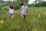 Young couple walking in a field