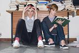 Teenagers reading books