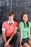 Portrait of a teenage boy and girl