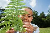 Boy with fern leaf