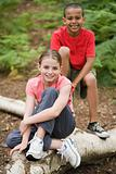 Boy and girl on log