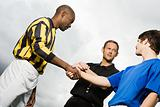 Rival footballers shaking hands