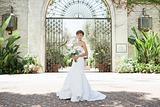 Bride standing in a courtyard