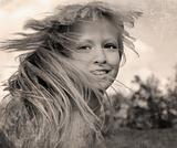 Retro style photo of happy girl with flying hair.jpg
