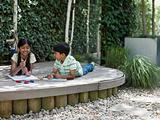 Children drawing in garden