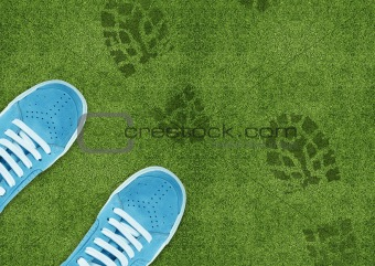 Shoe print on green grassland