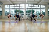Young women practising yoga