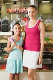 Mother and daughter in sweet shop