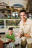 Father and son in sweet shop