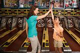 Mother and daughter playing arcade game