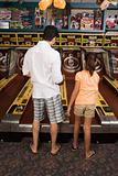 Father and daughter at amusement arcade