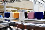 The colorful of the cone threads from textile factory