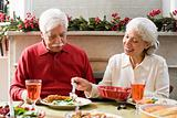 A man and woman having christmas dinner