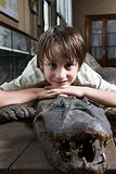Portrait of a boy on top of a crocodile
