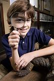 A boy holding a magnifying glass