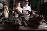 School students looking at crocodiles