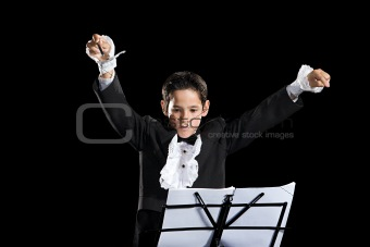 A boy pretending to be a composer