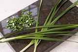 Spring onions on cutting board