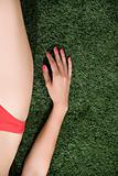 Woman lying on artificial turf