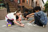 Kids drawing on sidewalk