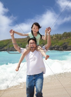 Happy girl and father on the beach