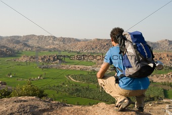 Backpacker looking at view