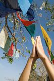 Prayer flags and woman praying