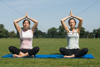 Women doing yoga in the park