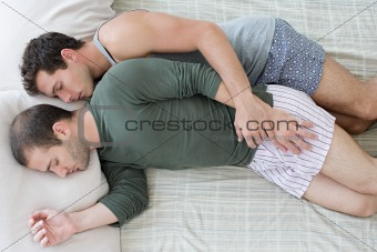 Gay couple sleeping
