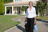 Woman leaving holiday home