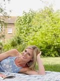 Woman relaxing in garden