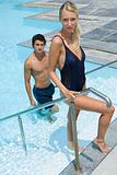 Couple coming out of swimming pool