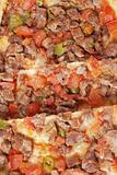 Pita bread with diced meat, green pepper and tomatoes