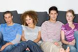 Friends sitting by sofa