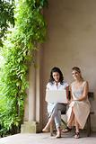 Women outdoors with laptop