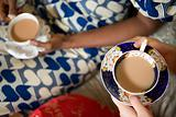 Two women in traditional clothing drinking tea