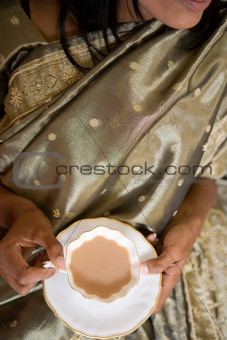 Indian woman drinking a cup of tea