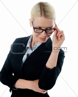 Corporate woman taking a closer look from within her glasses