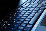 laptop keyboard as a background tonet to blue