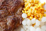 grilled pork steak with corn and small onions