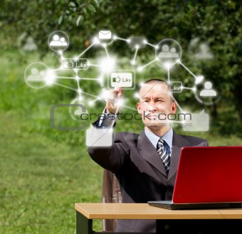 Man with Laptop Working Outdoors in Social Network
