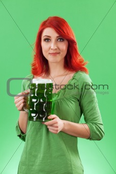 Beautiful female drinking green beer