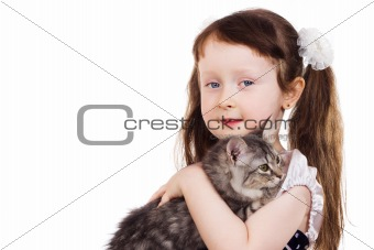 smiling little girl holding a kitten in her hands