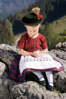 Little girls in Bavarian pray