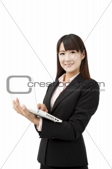 beautiful business woman holding laptop and isolated on white